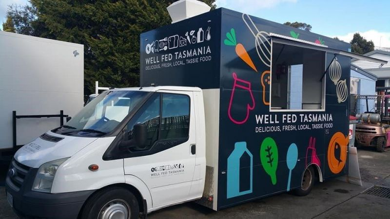 "Food Truck with the words ""well fed Tasmania.  Delicious, fresh, local Tassie food."