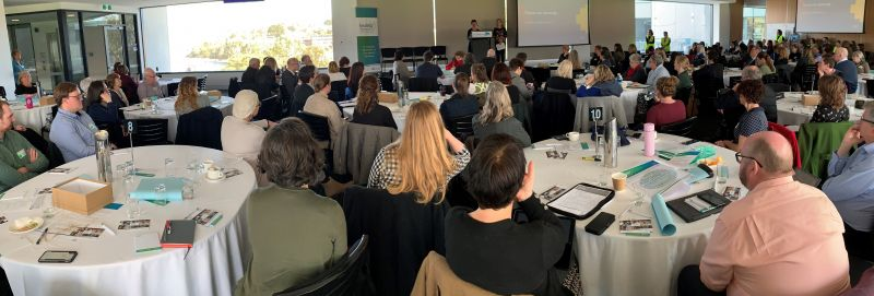 Guests at the Healthy Tasmania Community Forum listening to a keynote presentation from Professor Billie Giles-Corti.