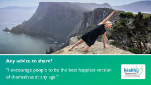 """Stacey doing a yoga pose on a rock cliff overlooking Cape Pillar in the distance. Her quote says, """"I encourage people to be the best happiest version of themselves at any age!"""""""